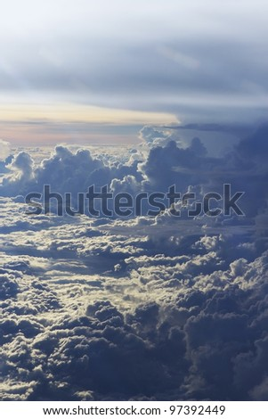 a dramatic beautiful sunset and cloud shot from above background - stock photo