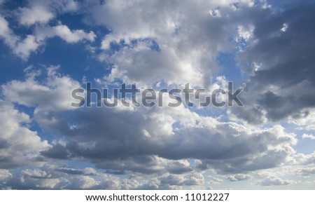 A dramatic blue sky with white clouds - stock photo
