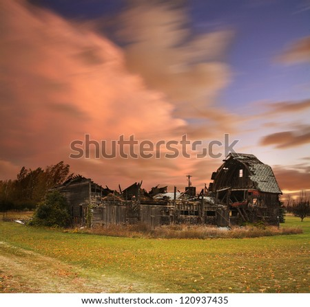 A Dramatic Cloudscape Of Restless Skies Above An Old Collapsed Barn Near Northport Michigan On A Stormy Day In Autumn, USA - stock photo