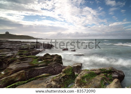 A dramatic Cloudy day by the beach--The North Coast, New Taipei, Taiwan - stock photo