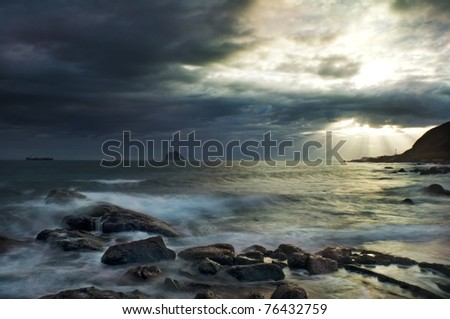 A dramatic Cloudy Morning by the beach--The North Coast, New Taipei, Taiwan - stock photo