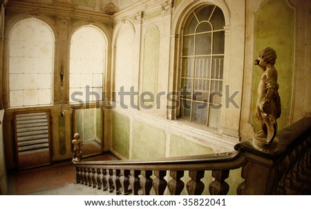 A dramatic marble staircase and sculpture of angel in old building in Florence, Italy. - stock photo