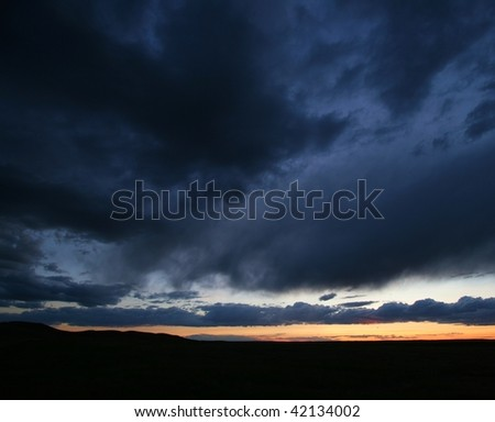 A dramatic sky during sunset. Writing-On-Stone Provincial Park, Alberta, Canada. - stock photo
