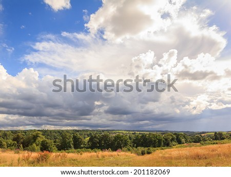 A dramatic sky with clouds over Roslin, Scotland - stock photo