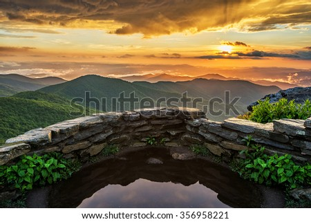 A dramatic summer sunset from Craggy Gardens along the Blue Ridge Parkway in North Carolina  - stock photo