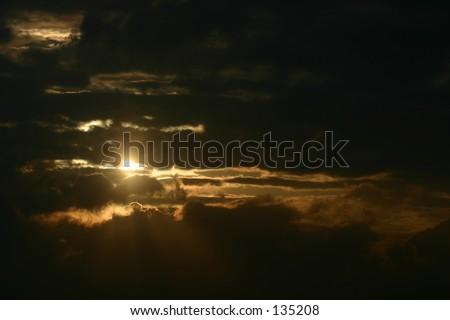 A dramatic sunrise, suggesting hope, faith, and promise. - stock photo