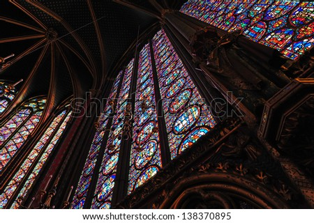 A Dramatic view looking up at the extraordinary stained glass windows of St. Chappelle Cathedral in Paris, France - stock photo