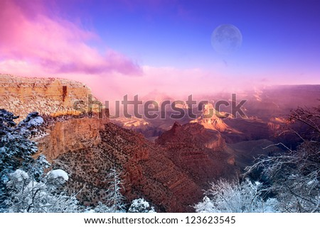 A dramatic winter image of the Grand Canyon shot at the Bright Angel Village overlook at the South Rim in Arizona during December. - stock photo