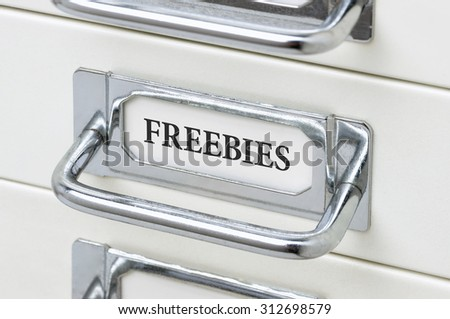A drawer cabinet with the label Freebies - stock photo