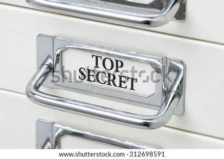 A drawer cabinet with the label Top Secret - stock photo