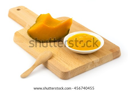 a dressing made from pumpkin on white background.