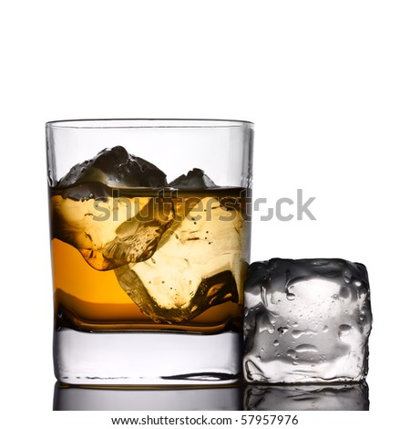 A drink on the rocks with ice-cube - stock photo