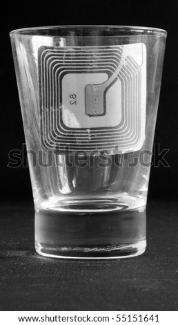 A drinking glass with security tag