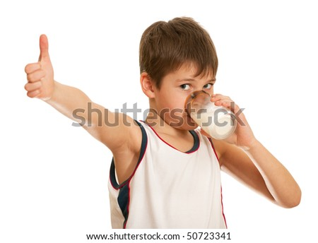 A drinking milk boy is showing his thumb up; isolated on the white background