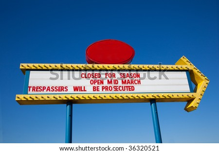 A drive-in movie marquee in front of a bright blue sky with copy space - stock photo