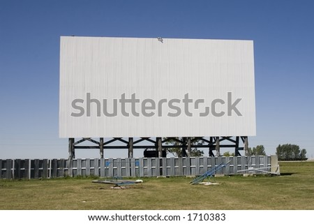 A drive-in movie screen. - stock photo
