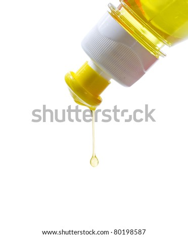 a drop of yellow detergent - stock photo