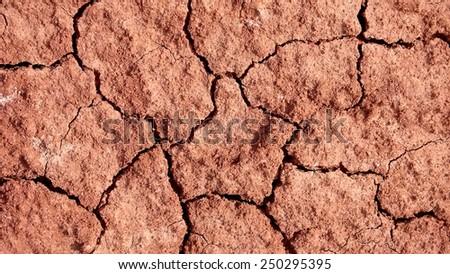 A dry red desert cracking beneath my feet - stock photo