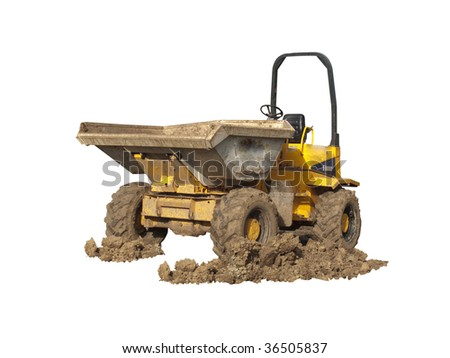 A Dumper Truck on a construction site with muddy wheels - stock photo