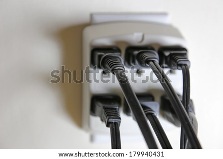 A duplex-to-six outlet adapter with no open outlets.  - stock photo