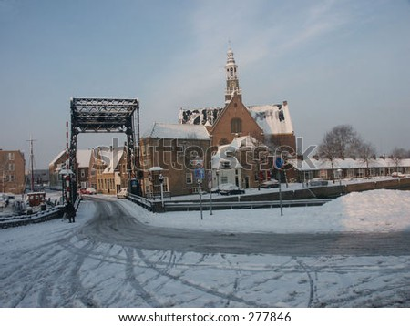 A Dutch city covered in snow. The city name is Maassluis which stands for a lock in the river Maas. - stock photo