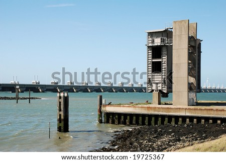 A dutch storm surge that protects the land below sea level against floods and a spare slide for the surge for use in case of emergencies - stock photo