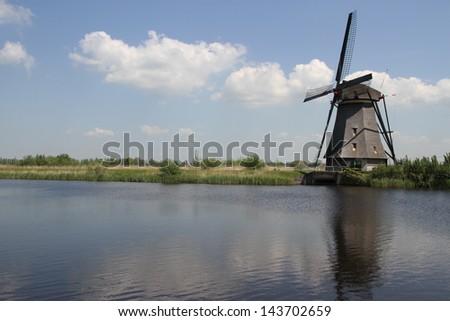A Dutch windmill near Kinderdijk, The Netherlands - stock photo