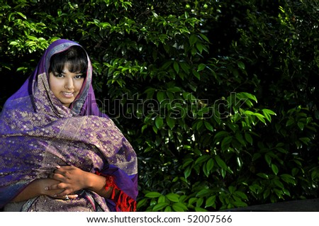 A East Indian woman wearing a traditional head scarf - stock photo
