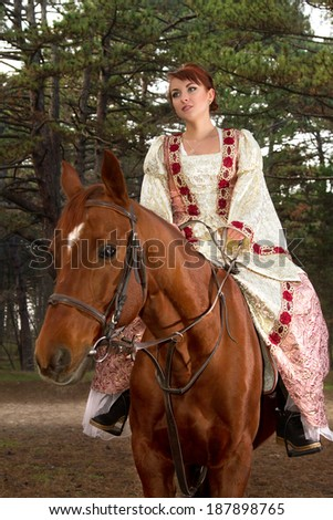 a eautiful girl in antique dress on horseback b