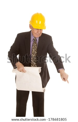 a elderly man in his hard hat holding on to his construction plans. - stock photo