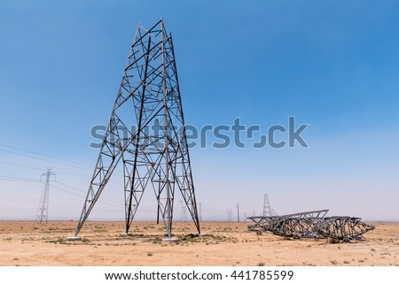 A electrical tower pylon under construction in the desert - stock photo