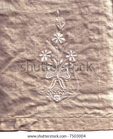 A embroidered linen hand-towel, suitable for a background texture. - stock photo