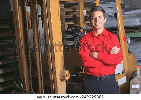 A employee of a hardware store at work - stock photo