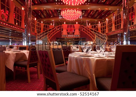 A empty dining room decorated in red fabric - stock photo