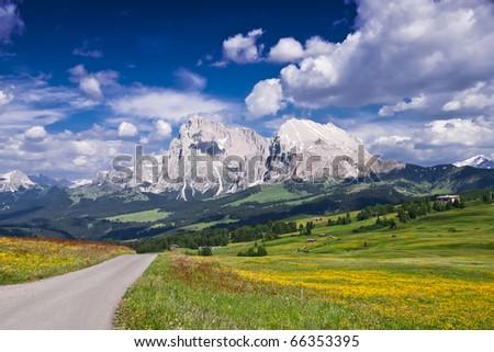 A empty road in Alpe Di Siusi, in the Italian Alps. - stock photo