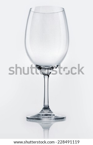 A empty wine glass close up isolated white. - stock photo