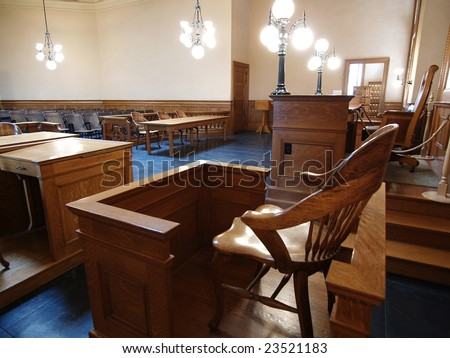 A empty witness chair inside a classic American courtroom. - stock photo