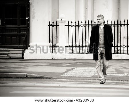 A  enters the road at a pedestrian crossing - stock photo
