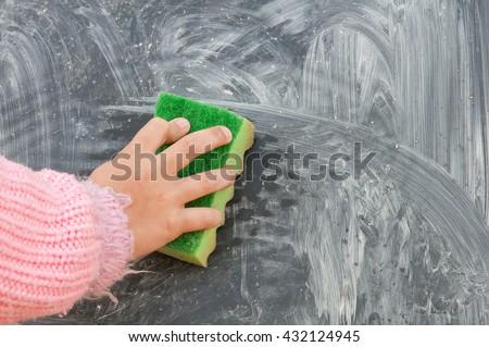 A Erasing the blackboard. Close up - stock photo