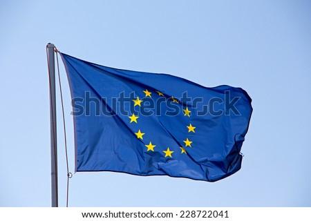 A EU flag against the sky - stock photo