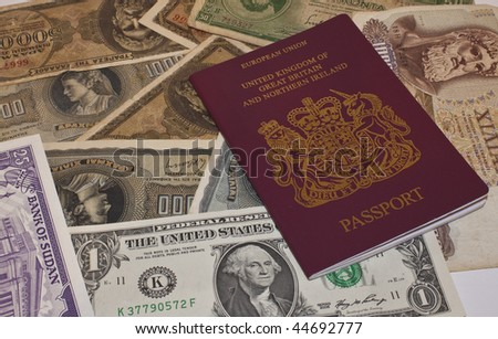 a european passport with foreign currency ready to travel - stock photo
