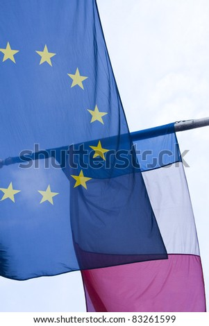 A European Union flag and a French flag flying together