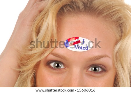A  excited young woman voter with a sticker. - stock photo