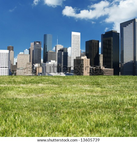 A expansive green hillside overlooking downtown Houston Texas - stock photo