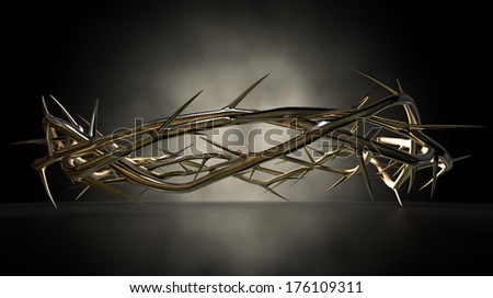 A eye level view of a gold casting sculpture of branches of thorns woven into a crown depicting the crucifixion on a dark reflective surface spotlit by an eerie light - stock photo