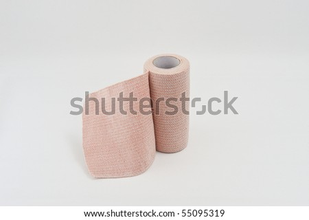 A fabric bandage isolated on a white background - stock photo