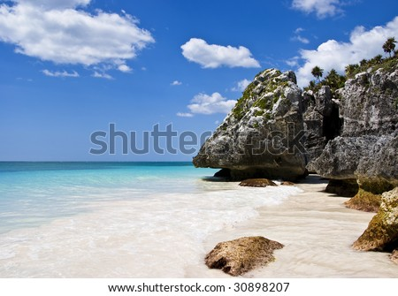A fabulous beach in Tulum, Mexico. Turquoise water and deep blue sky. - stock photo