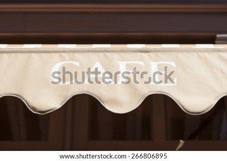 A facade(sign) of cafe in the vintage house(building) at the daylight. - stock photo