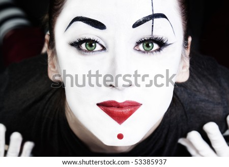 A face of beautiful woman mime with green eyes  close up - stock photo