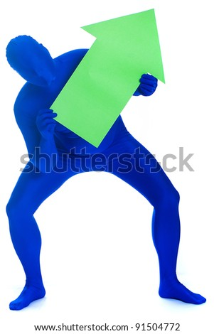 A faceless man in a blue body suit holding a green arrow pointing up. - stock photo